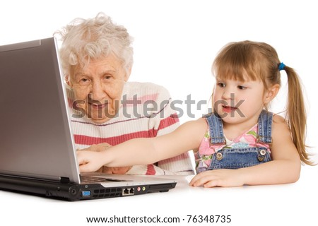 Grandmother with grand daughter at the computer - stock photo