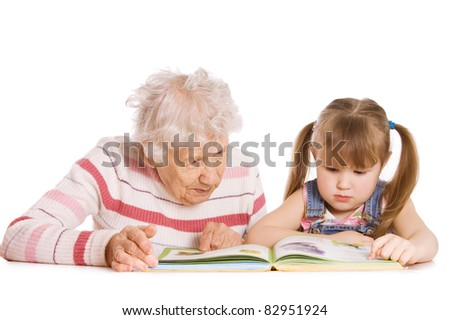 Grandmother with grand daughter read the book - stock photo