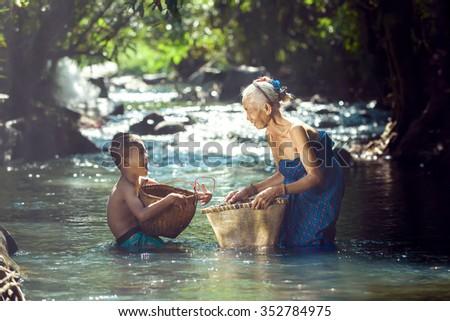 Grandmother with grandchildren be happy,Nhongkhai,Thailand. - stock photo