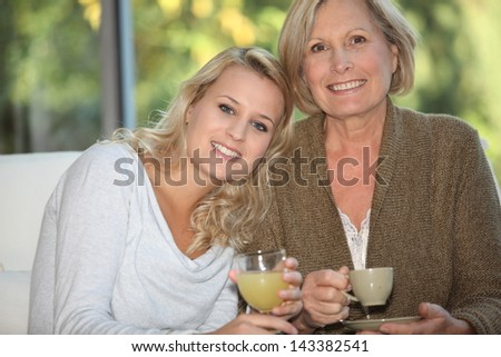Grandmother with granddaughter - stock photo