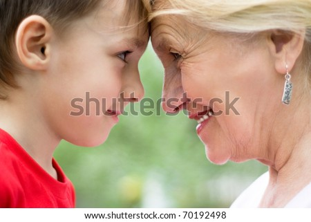 Grandmother with grandson on nature face to face - stock photo
