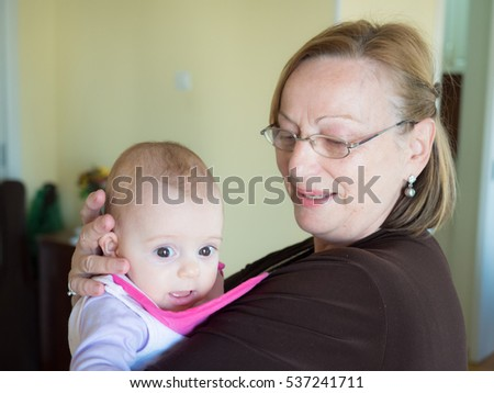 Grandmother with her grandchild, little baby girl.