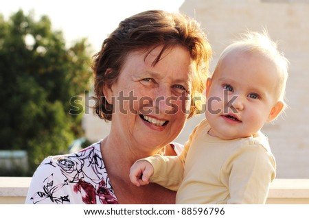 grandmother with her granddaughter - stock photo