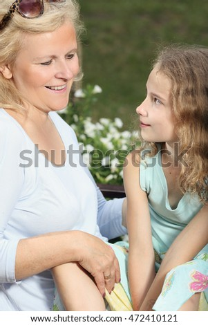 Grandmother with her granddaughter spending time together in the garden