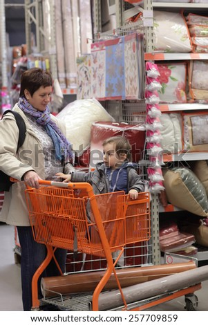 Grandmother with her grandson at the store - stock photo