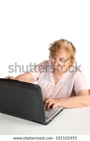 grandmother with  laptop on the white