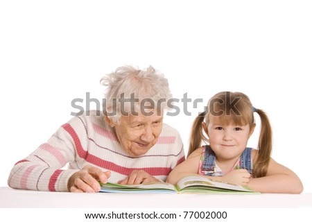 Grandmother with the grand daughter read - stock photo