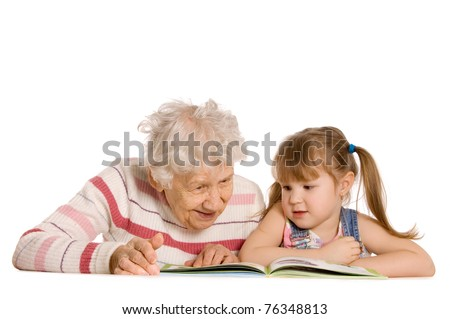 Grandmother with the grand daughter read the book - stock photo