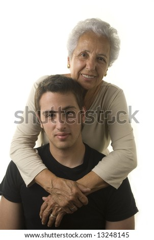 Grandmother with young grandson in the studio - stock photo