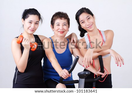 Grandmother working out with young ladies. - stock photo