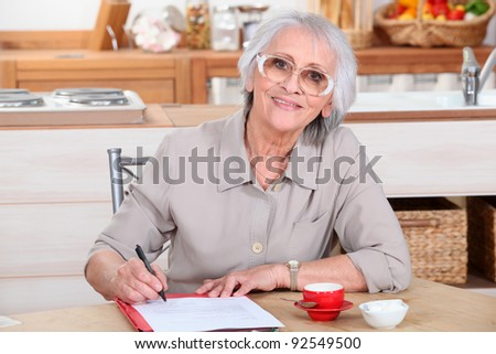 grandmother writing - stock photo