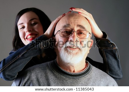 grandpa and granddaughter smiling together - stock photo