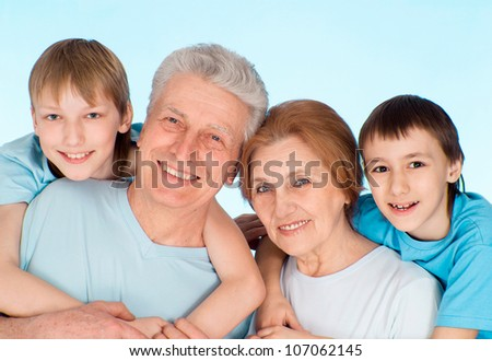 Grandpa and Grandma having fun leasure with their grandchildren
