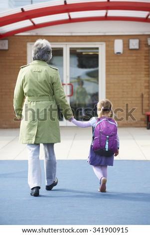 Grandparent Taking Grandchild To School - stock photo