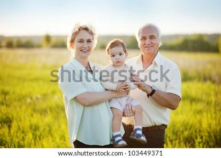 Grandparents and grandchild - stock photo