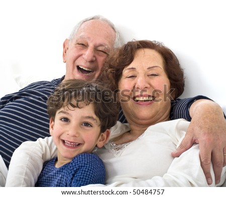 grandparents and grandchild in bed together