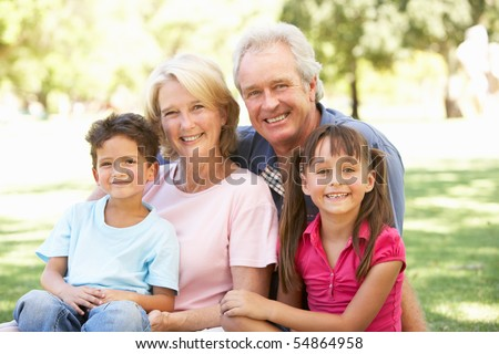 Grandparents And Grandchildren Enjoying Day In Park - stock photo