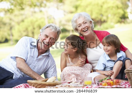 Grandparents And Grandchildren Enjoying Picnic Together - stock photo
