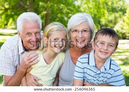Grandparents and grandchildren in the park on a sunny day