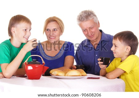 grandparents and kids eating cookies on white
