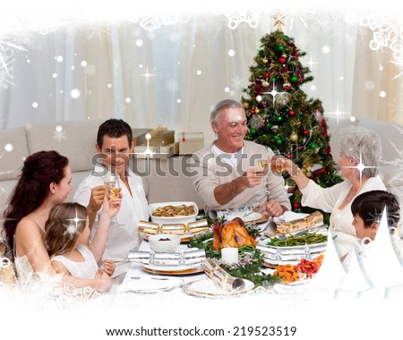 Grandparents and parents toasting in a Christmas dinner against snow falling