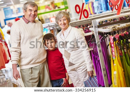 Grandparents and their grandson in the mall - stock photo
