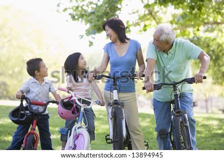 Grandparents bike riding with grandchildren - stock photo
