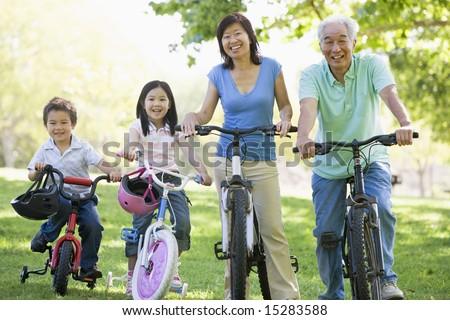 Grandparents bike riding with grandchildren. - stock photo