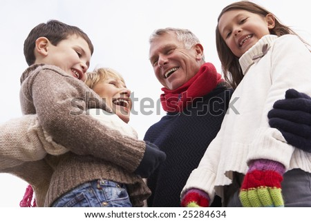 Grandparents Hugging Their Grandchildren - stock photo