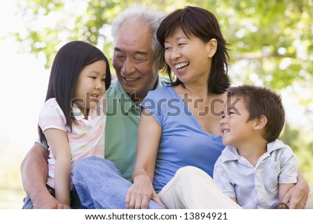 Grandparents laughing with grandchildren - stock photo