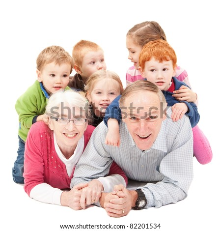 Grandparents lying on floor with grandchildren. Isolated on white. - stock photo
