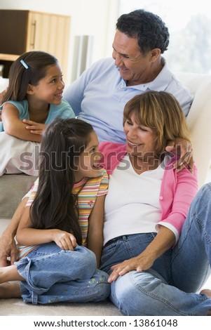 Grandparents talking with grandchildren - stock photo