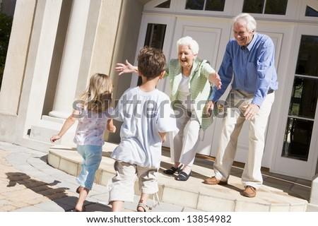 Grandparents welcoming grandchildren - stock photo