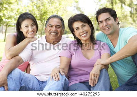Grandparents With Adult Children In Park - stock photo