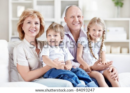 Grandparents with grandchildren at home