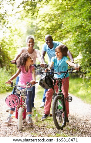 Grandparents With Grandchildren On Cycle Ride In Countryside - stock photo