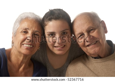 Grandparents with granddaughter in a studio shoot - stock photo