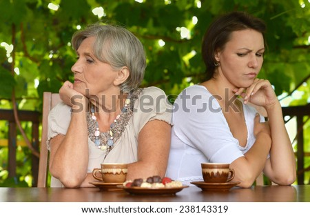 Grandparents with grandsons reading - stock photo