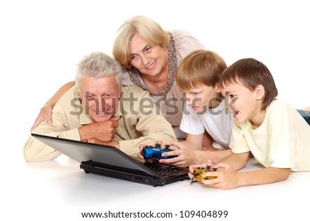 Grandparents with their fine grandchildren on a white background - stock photo