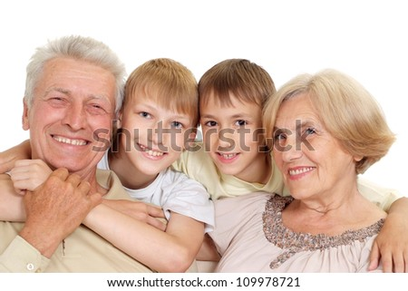 Grandparents with their honey grandchildren on a white background - stock photo
