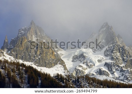 Grands Charmoz, to the left, 3445 m, and Aiguille du Blaitiere, 3522 m, Aiguilles du Chamonix, Mont Blanc Massif, Alps, Chamonix, France - stock photo