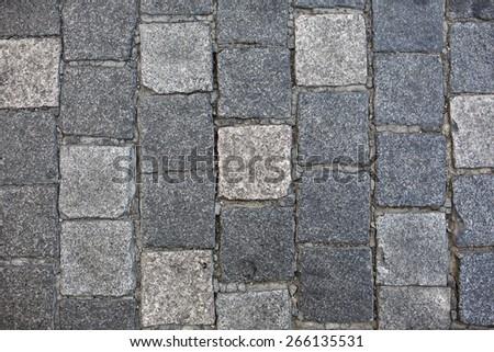 Granite cobble stone pavement background texture. - stock photo