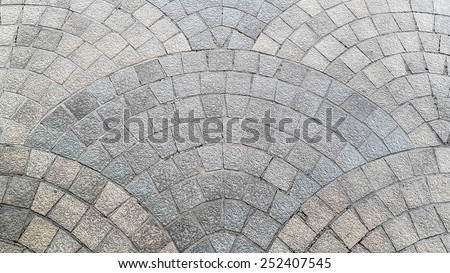 Granite cobblestoned pavement texture background - stock photo