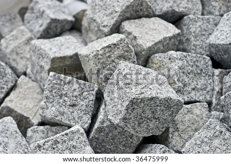 granite cube blocks. Shallow DOF - stock photo