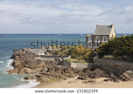 Granite house on cliffs in Brittany - Saint-Malo, Brittany, France - stock photo