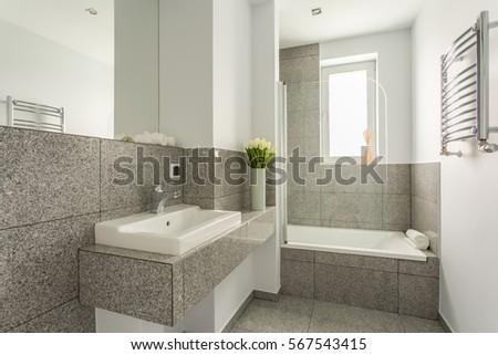 Granite modern bathroom interior with minimalist washbasin and bathtub. Washbasin Stock Images  Royalty Free Images   Vectors   Shutterstock