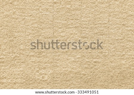 Granite rock stone tile wall aged texture detailed pattern background in light yellow beige creme cream color tone: Ancient rustic granite patterned backdrop for interior and architecture decoration - stock photo