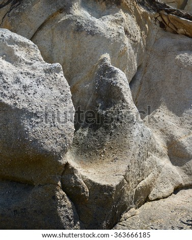 Granite rocks background. The rocks erode to form the famous Golden Bay gold coloured sands and are studded with lumps of sparkling quartz.  - stock photo