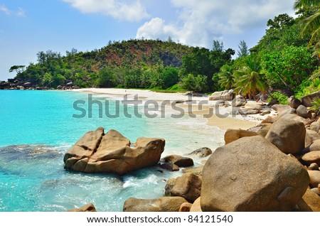Granite rocky beaches on Seychelles islands, Praslin, Anse Georgette - stock photo