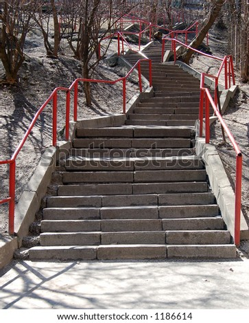 granite stairs with red railing - stock photo